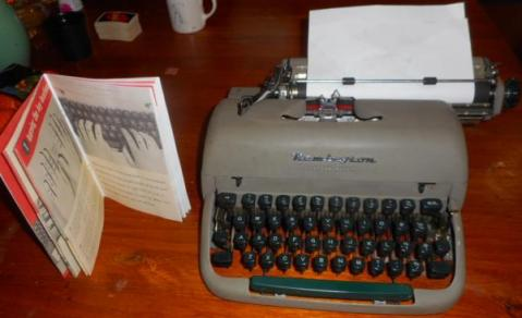 photo of the typewriter and manual.
