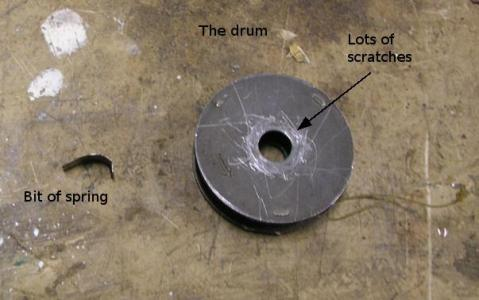 Photo showing the drum and spring.