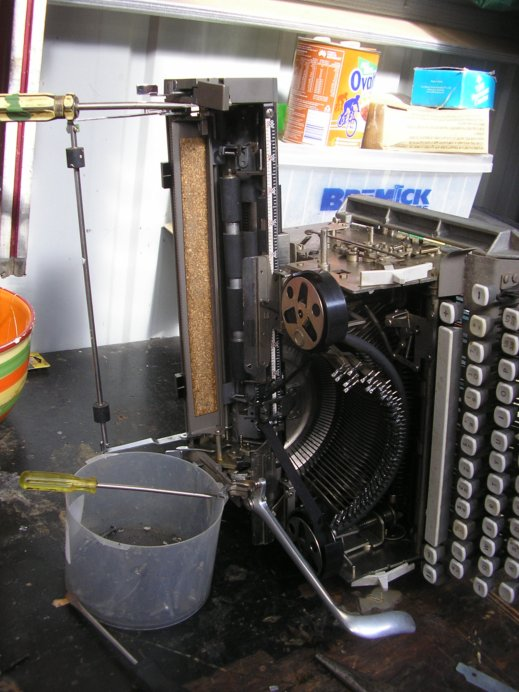 Photo odf the machine out of the case and on its side.