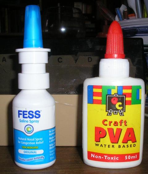a bottle of nasal spray and a small bottle of PVA glue.